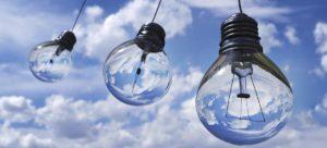Light bulbs floating in sky