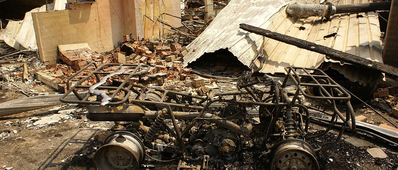 Burnt out house and quad bike - Image by MarkJToomey from Pixabay